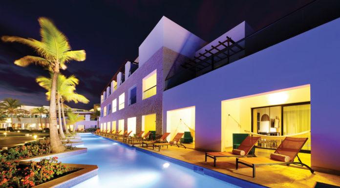 Top: Swim-up Junior Suites at TRS Cap Cana Hotel.